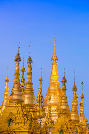 Golden stupa of Shwedagon Pagoda at twilight, Yangon, Myanmar photo