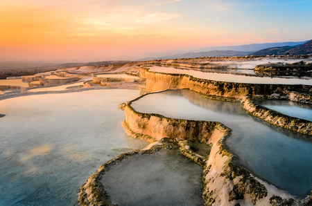 Carbonate travertines the natural pools during sunset, Pamukkale, Turkey Stock Photo