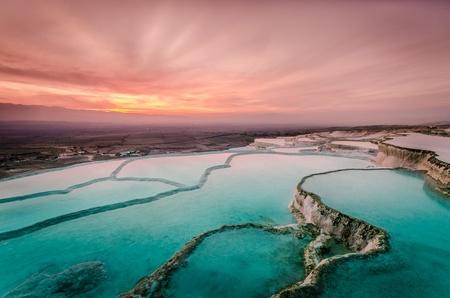 Carbonate travertines the natural pools during sunset, Pamukkale, Turkey