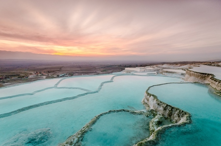 Carbonate travertines the natural pools during sunset, Pamukkale, Turkey Stock fotó