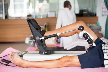 patient on CPM device and working, case post operation of knee joint with limitted range of motion using CPM (continous passive motion machine) in physical therapy department of hospital