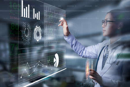 smart doctor holding hand and touching on screen of information data with patient vital sign in ICU room, illustration digital medical technology Stock Photo