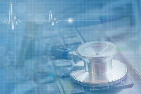 medical concept, double exposure of stethoscope on black keyboard and illustration ECG wave Stock Illustration - 111437783