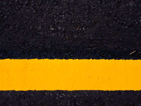 close up road surface, yellow traffic line on road Imagens