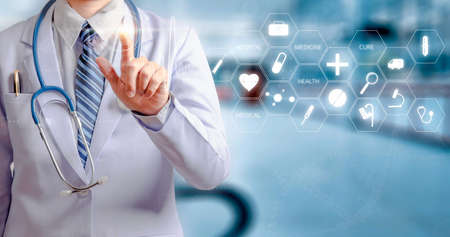 woman doctor holding hand and touching visual screen with hospital background Banco de Imagens