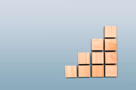 wooden cube stacked in step shape with space in cube for content Stockfoto
