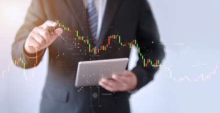 business man pointing index finger to forex graph Stockfoto