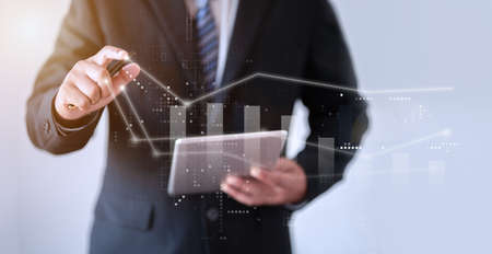 business man pointing index finger to end of white line and stock graph