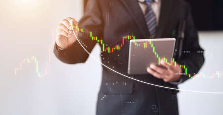 business man holding pen and writing white line of forex trend
