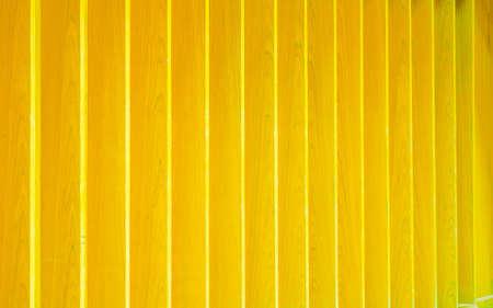 Yellow lath wooden wall, wall wooden lath pattern