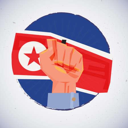 北朝鮮国旗を手拳