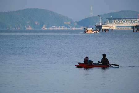 One of the beaches, 2010 - father to son to hunt, fish, paddle boat in the waters industrial district in the afternoon.