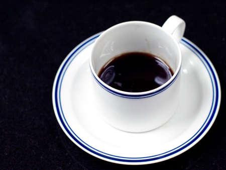 white cup with dark coffee Standard-Bild