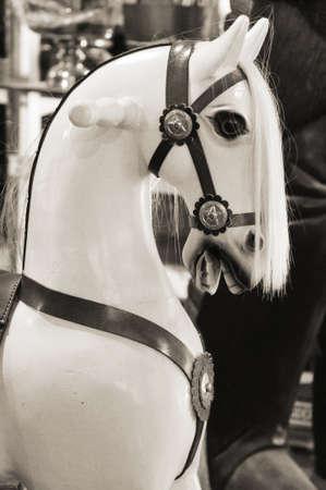 carrousel: Ancient wood horse, black   white