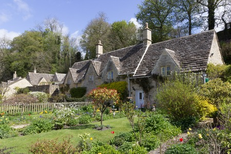 A row of picturesque, historic cottages in the village of Bibury, in the Cotswolds, UK