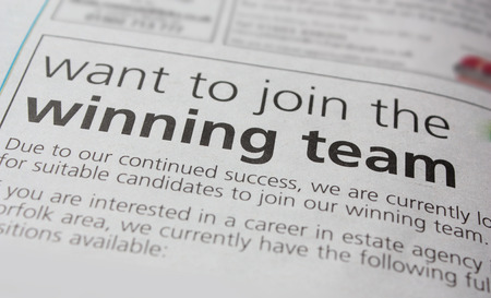 job advertisement: Job advert in a newspaper, inviting applicants to join the winning team  Stock Photo