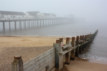 southwold: A sea mist partially shrouding Southwold Pier  Stock Photo