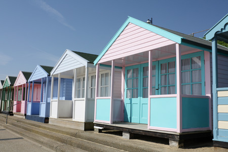 Colourful beach huts on seafront at Southwold, Suffolk, England photo