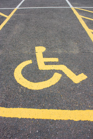 signifies: A wheelchar disability sign, signifies a car parking space reserved for disabled