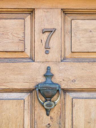 Wooden door, with black metal doorknocker and No  7 photo