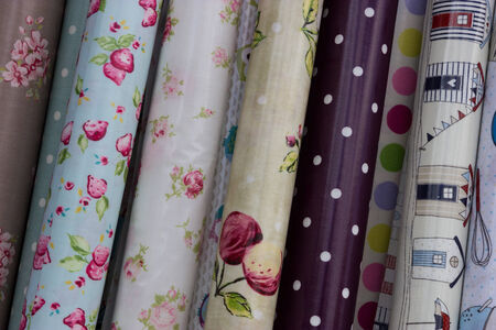 Rolls of oilcloth designs in a home interiors shop