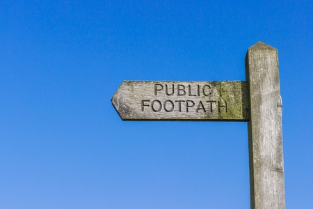 rambling: Wooden Public Footpath sign against a clear blue sky