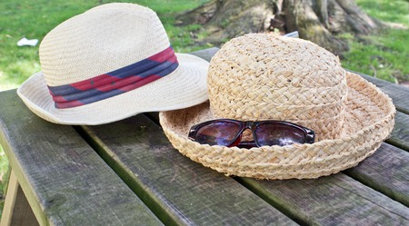 possibly: Two straw sun hats possibly belonging to two seniors
