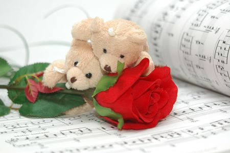 teddy bear love: bear with musical score as background Stock Photo