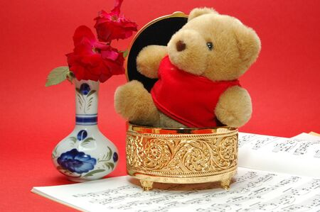 bear with gold box photo