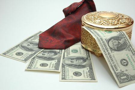 money with tie and a golden box photo