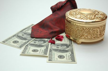 cash cow: money with tie and a golden box Stock Photo