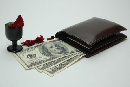 money from the wallet with flower pads photo