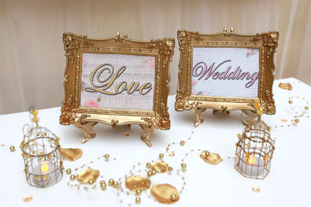 Two golden wedding frames photo