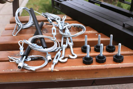 Bolts, fastening, rope lying on a wooden bench photo