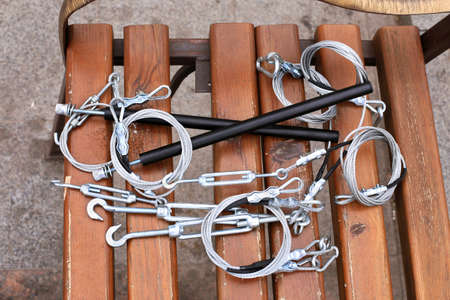 Hooks, fastening, rope lying on a wooden bench photo