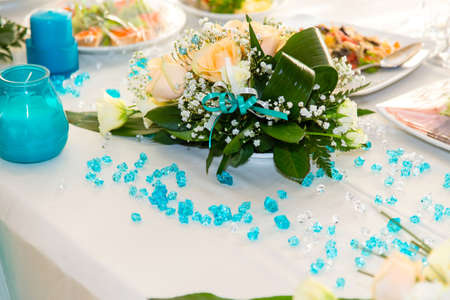 Bouquet Of Roses And Turquoise Decoration On The Wedding Table Stock ...