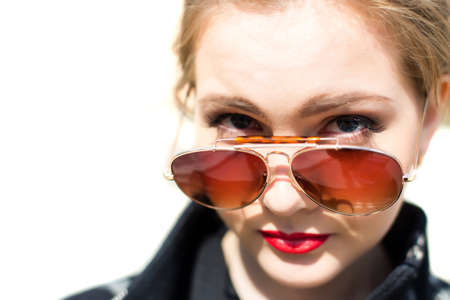 Portrait of a girl in sunglasses closeup shallow depth of field photo