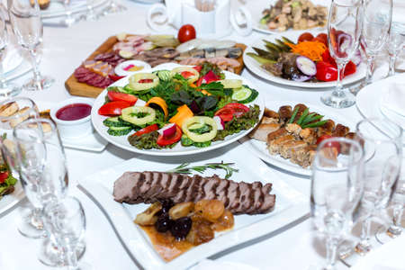 salad buffet: salad and cold meats at the banquet table Stock Photo