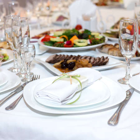 serviette: serviette on a plate on the holiday table served with various dishes Stock Photo