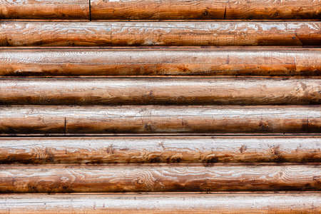 calibrated: part of the wall made of wooden logs