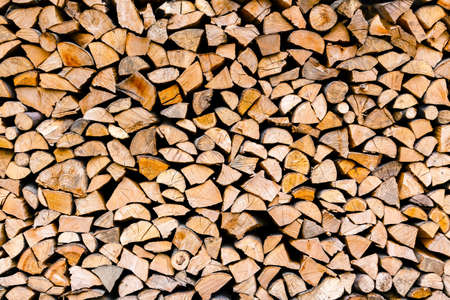 woodpile: Minced wooden logs stacked in the woodpile Stock Photo