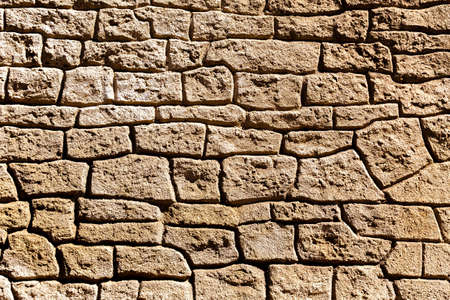 calibrated: Detail of the structure of the old stone wall