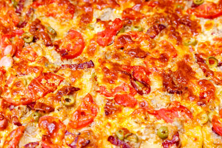 fast food: Delicious juicy pizza closeup. For background Foto de archivo