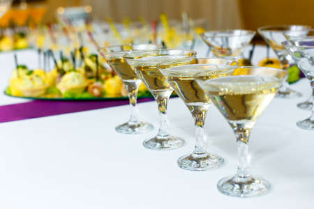 banquet table: Four glasses of champagne on the banquet table