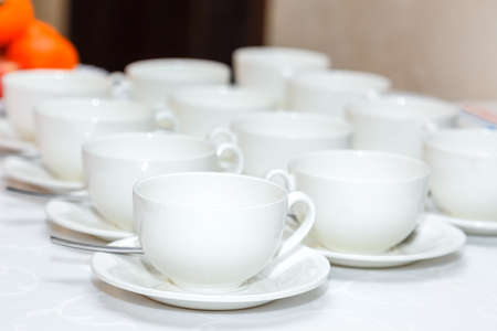 several: several white coffee cups on a banquet