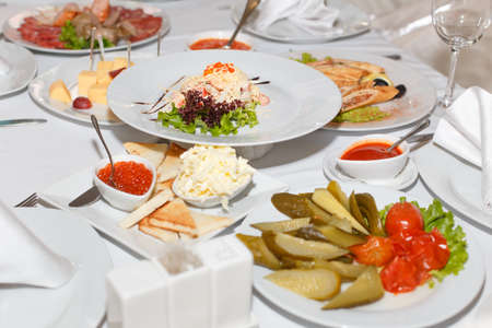 banket: Pickles, salad, caviar and dishes on holiday table in restaurant Stock Photo