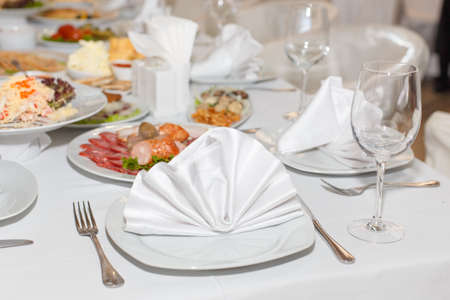 banket: cutlery on the white banquet table in restaurant