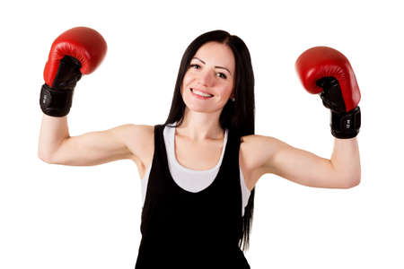 long gloves: Smiling brunette girl with long hair in red boxing gloves raised their hands up concept - a victory isolated on white background in studio