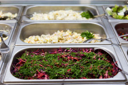 Salads in restaurant on the metal plates. selective focus