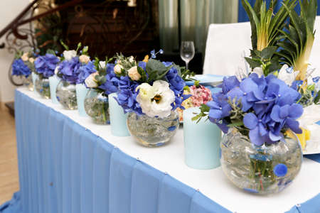 Decoration of wedding table with candles and flowers in blue tones, selective focus